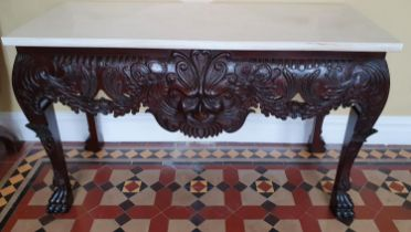 A fantastic Irish Mask Table in the Georgian style with highly carved front, hairy paw feet and
