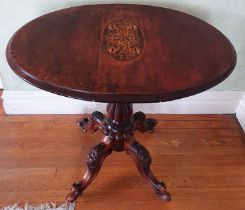 A late 19th early 20th Century oval Walnut Side Table with drop leaves on a turned carved base,