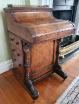 A Superb early 19th Century Walnut 'Jack in The Box' Davenport with rise and fall top mechanism,