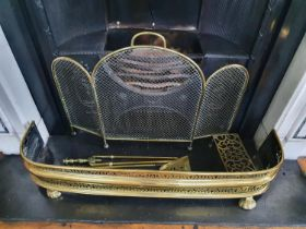 A 19th Century Brass Pierced Fender along with a 19th Century Brass and Mesh Spark Guard and