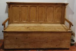 A very large 19th Century stamped Pine Settle with lift up seat and panelled back H129 x D63 x