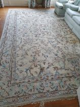 A very large cream ground Carpet with unique allover decoration and multi borders. 460 x 370cm