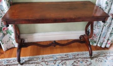A 19th Century Walnut rectangular Centre Table with an inlaid top, lyre ends and a stretcher base.