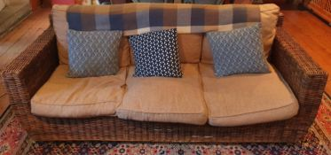 A good Wicker three seat Couch and Coffee Table. H88 x D82 x W207cm approx.