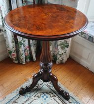 A 19th Century Walnut Crossbanded Circular Wine Table with a highly carved fluted tripod base and