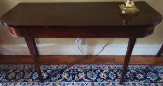A Georgian Mahogany Side table with tapered supports. W134 x D55 x H71cm approx.