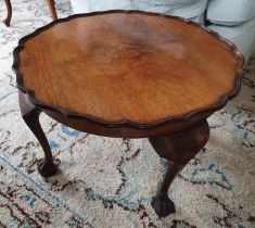 An Edwardian Walnut low Side Table with scalloped edge on ball and claw feet. Diam.60 x H39cm