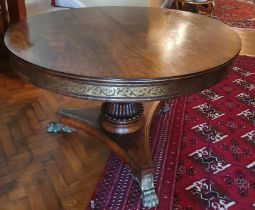 A Magnificent Regency Rosewood circular Centre Library Table with Brass inlay. The Frieze