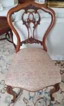 A lovely pair of 19th Century Walnut Chairs with highly pierced backs and carved supports. Back