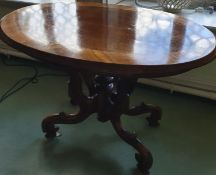 A late 19th Century Walnut oval Centre Table with swept support base. H78 x D76 x W120cm approx.