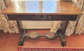 An early 19th Century triple drawer Side Table with stretcher base. H74 x D48 x W104cm approx.
