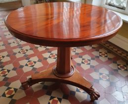 A Victorian Mahogany circular Centre Table with platform base and hairy paw feet. D90 x H72cm