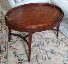 A Georgian Mahogany oval Butlers Table with gallery topped tray on a later base. 76 x 59 x H48cm