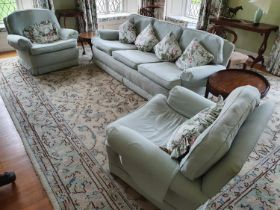 A good green Upholstered three piece Suite. Couch W220 approx, a chair 97cm approx.