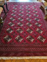 A Persian Surok Village Carpet full pile handwoven Red field with a central medallion with hints