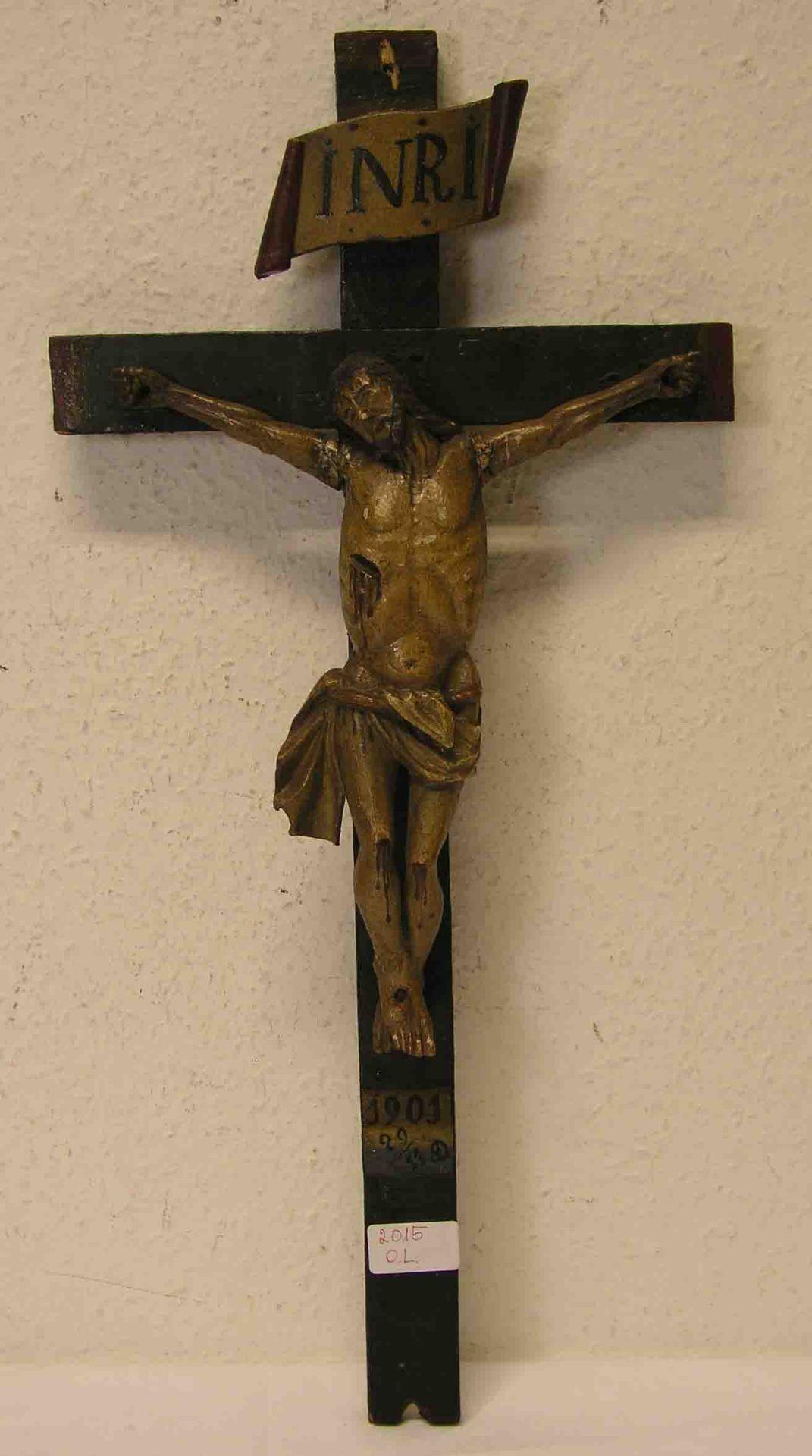 Kruzifix. Holz geschnitzt. Datiert