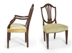 Menorcan Hepplewhite style chairs, ca.1790. 2 armchairs and 10 chairs. Walnut wood. Measurements: 94