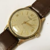 HM 9CT GOLD LONGINES GENTS WRISTWATCH -WORKING, NEEDS A SERVICE