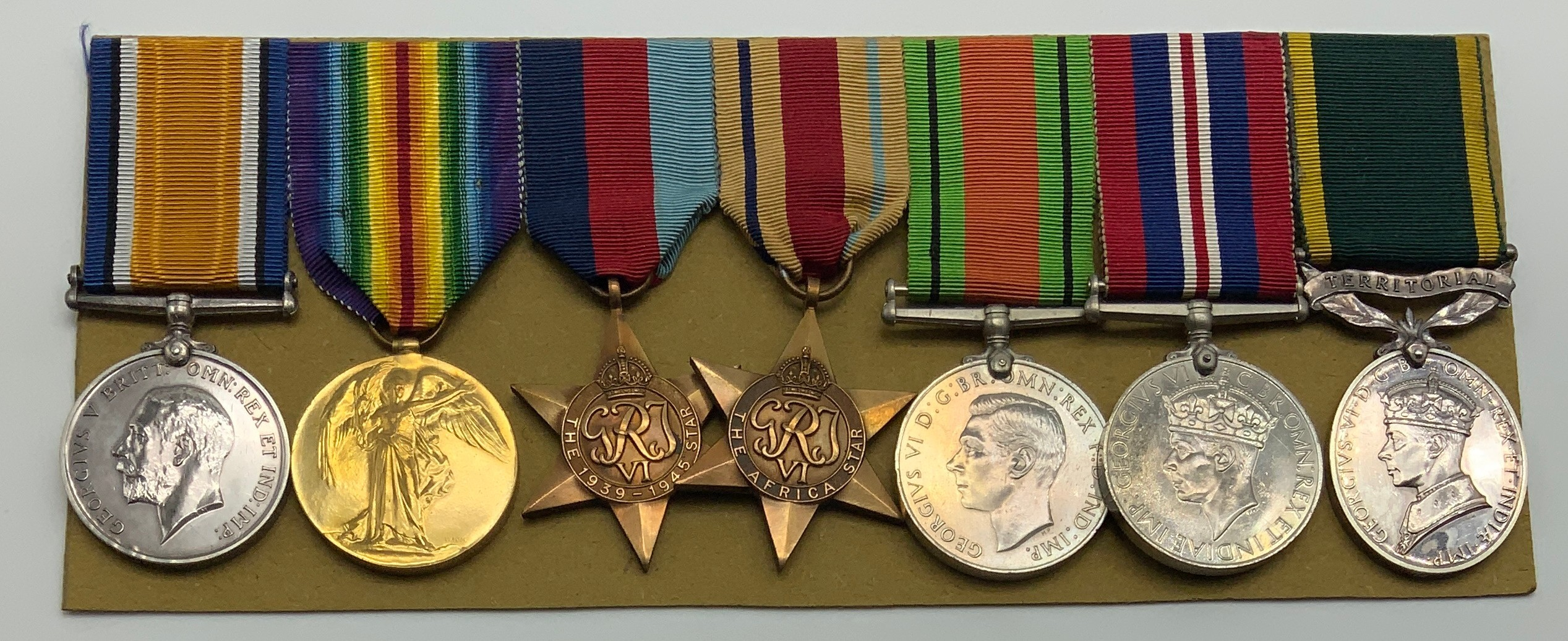 A WWI & WWII GROUP OF SEVEN MEDALS INCLUDING TERRITORIAL EFFICIENCY SERVICE MEDAL