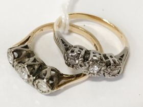 TWO THREE STONE DIAMOND RINGS - 18CT GOLD - SIZE K