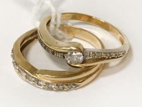 TWO 18CT GOLD DIAMOND TWIST RINGS - RING SIZES P & Q