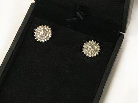 1 CARAT TOTAL DIAMOND CLUSTER EARRINGS SET IN WHITE GOLD