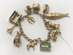 9CT GOLD CHARM BRACELET - APPROX 46 GRAMS