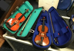 TWO 1/4 SIZE CASED VIOLINS