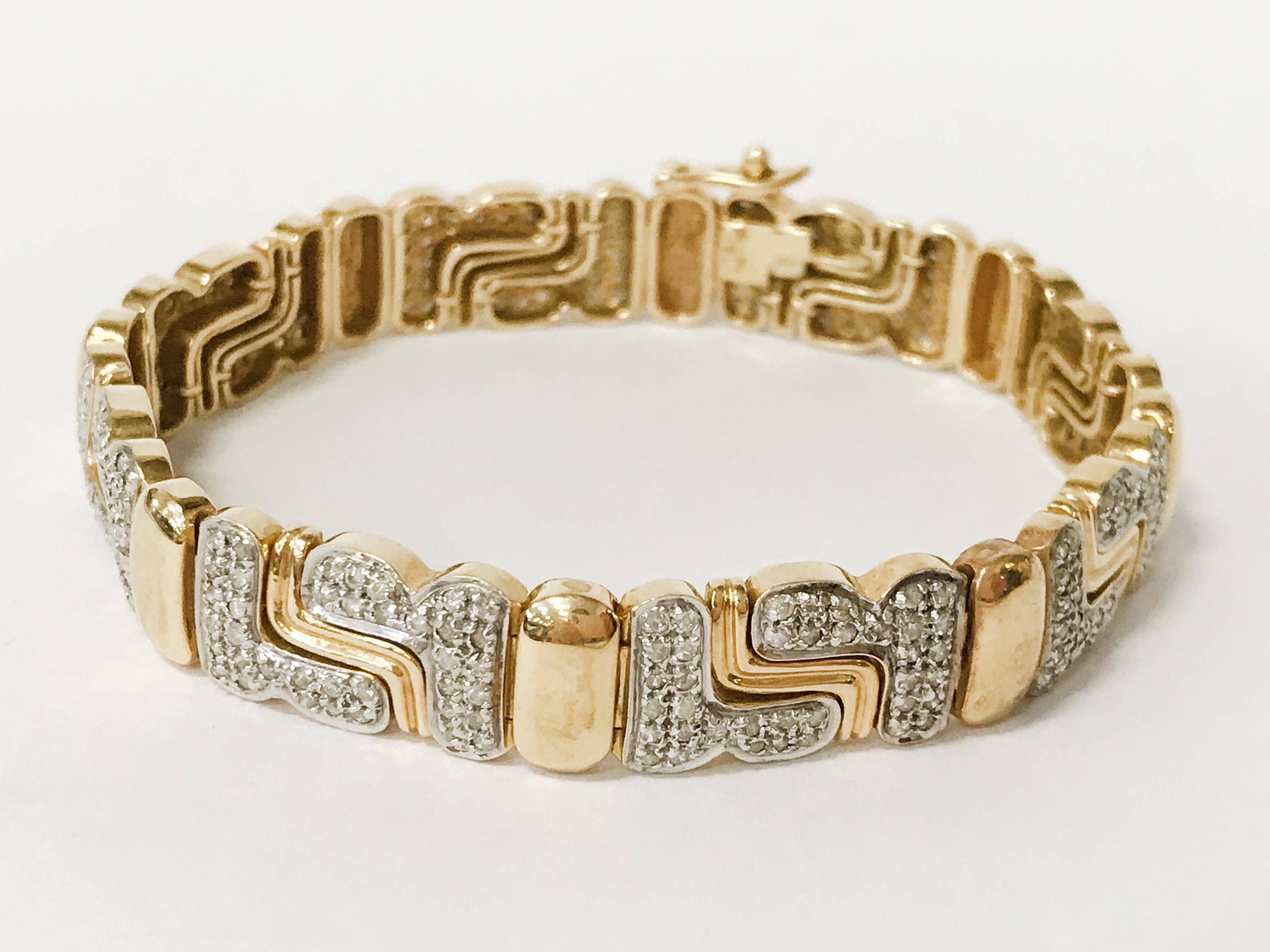 18CT GOLD & DIAMOND BRACELET - APPROX 36 GRAMS