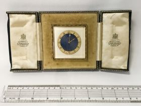 EARLY SWISS GILT & ENAMEL DESK CLOCK COMPLETE WITH ITS ORIGINAL CASE, SUPPLIED BY SKINNER & CO,