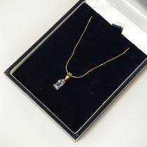 9CT GOLD 16'' CHAIN WITH AN AQUAMARINE PENDANT