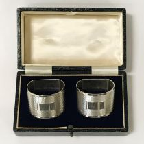 PAIR OF BOXED SILVER NAPKIN RINGS