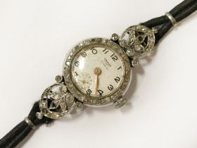 GLEATURN LADIES COCKTAIL WATCH IN PLATINUM & DIAMONDS (3 STONES MISSING) WORKING BUT NEEDS A