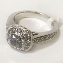 PLATINUM SOLITAIRE RING WITH A CUSHION CENTRE HALF CARAT CENTRE TOTAL 0.90 CARATS - SIZE 9