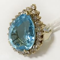 14CT YELLOW GOLD BLUE TOPAZ (18.84CT) WITH DIAMOND SURROUND RING -SIZE I & FULL CERTIFICATE