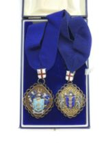 THE WORSHIPFUL COMPANY OF BASKETMAKERS TWO HALLMARKED SILVER JEWELS / MEDALS WITH COLLARS