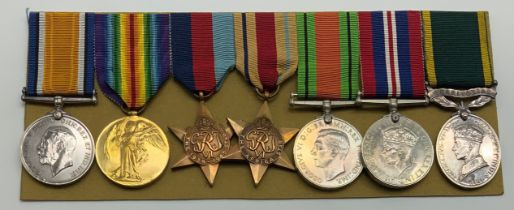 A WWI & WWII GROUP OF SEVEN MEDALS INCLUDING TERRITORIAL EFFICIENCY SERVICE MEDAL TO PTE S. HALL
