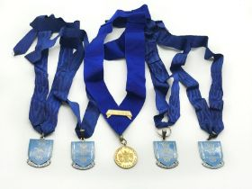 HALLMARKED SILVER BASKETMAKERS STEWARDS CLUB MEDAL AND FOUR METAL JEWELS WITH COLLARS