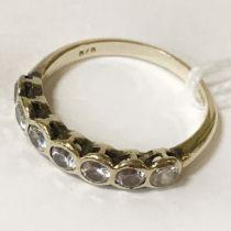 9 CARAT GOLD SEVEN DIAMOND RING (L)