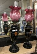 PAIR OF VICTORIAN CERAMIC OIL LAMPS WITH ORIGINAL HINKS NO.2 BURNERS & MATCHING PAIR OF CRANBERRY