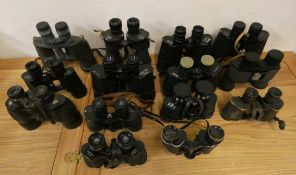 Thirteen pairs of binoculars, mainly cased, to include Ross and Helios-Prinzlux.