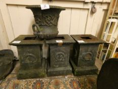 A set of three cast iron garden planter bases, with wreath decoration, 50 cm, together with a cast