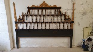 A black and gold painted ornate bed head, 210 cm wide, 175 cm high.