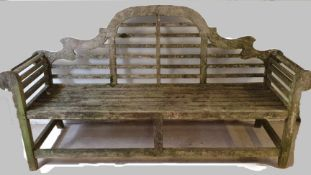 A hardwood garden bench with scroll arms, 197 cm and another bench, (one leg shorter)