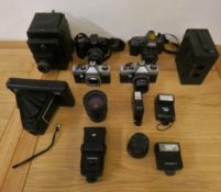 A collection of camera's, Victory Reflex, Praktica and a Bell & Howell cine camera, together with