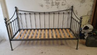 A Laura Ashley grey metal day bed and a white and brass single tester bed, some bolts missing (2).