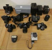 A collection of SLR cameras to include Olympus, Zenit, Chinon and Kodak, together with other