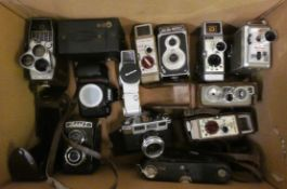 A collection of cameras and cine cameras, to include Nikon F70, Halina-Prefect and Bell & Howell