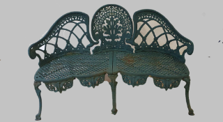 A cast iron green painted three seater garden bench.