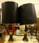 A pair of black and brass table lamps with shades.